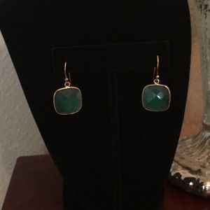 Green faceted earrings.